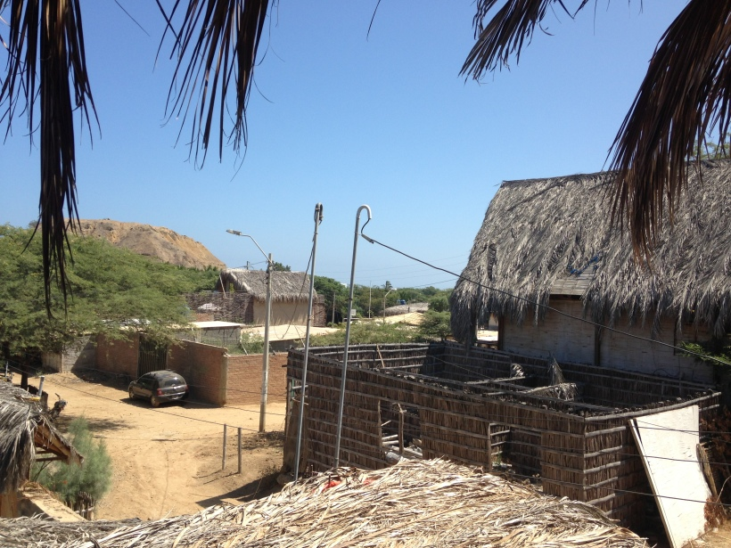 Past those thatched roofs= the beach. Yeah